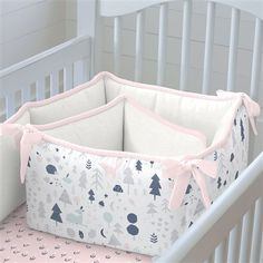 """Crib Bumper in Pink and Navy Baby Woodland by Carousel Designs. Our four-sided crib bumpers are produced in one continuous piece and fit standard cribs (using mattresses measuring approximately 28"""" x 52"""") and meet regulation standards with approximately 12"""" long ties and 2-3"""" thick batting, so that you can rest easy. Our crib bumper batting is made from recyclable hypoallergenic polyester fiberfill."""