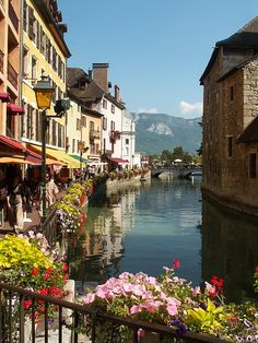 Annecy, France. Just went last weekend. love it! Beautiful lake with ice capped Alps in the background. Stunning!