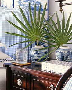 I love this from Brabourne Farm! This tiny look into this bedroom tells me all I need to know...blue and white, gingham, beautiful linens, and best of all, palm fronds... which means someplace warm!