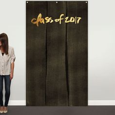 Create a theme for your graduation party decorations using our photo backdrop as a giant focal point. This wall hanging features our black-washed kraft paper pattern in the background, and your class year is printed at the top with a font of gold faux foil.