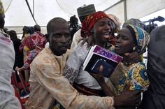 21 Nigerian Girls, Reuniting With Parents, Tell of Boko Haram Slavery. A joyful ceremony, parents of the freed Chibok schoolgirls heard them describe their two years of captivity. Kidnapped Girl, Nigerian Girls, Bbc World Service, Boko Haram, New Africa, Africa News, Girl Reading, Tears Of Joy, Pictures Of The Week
