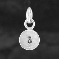 and silver tag charm by fi mehra