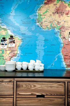 Map mural as wallpaper at Coffee Collective in the food market in Copenhagen, Denmark   Scandi style