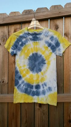 Blue and Yellow Tie Dye Shirt, Size Small.    This is a 100% cotton, handmade tie-dye shirt. It is custom created to be one of a kind. The
