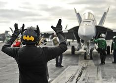 PACIFIC OCEAN (Oct 31, 2012) Aviation Boatswain's Mate (Handling) 2nd Class Andre Taylor directs a fixed wing aircraft while dressed in costume during Halloween day on board the aircraft carrier USS Nimitz (CVN 68). Nimitz is currently underway participating in Composite Training Unit Exercise. (U.S. Navy photo by Mass Communication Specialist 3rd Class Ryan J. Mayes/Released)