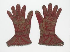 Pair of gloves | museum no. 437 | Spanish, 16th c | These gloves were hand-knitted in stocking stitch from red silk and yellow silk wrapped with silver strip. They were made for a bishop and are decorated with religious symbols. These include a cross surmounting a heart, a shepherd's crook or bishop's crozier to the left, and a reliquary to the right. The cuffs are patterned with geometric designs and a Greek wave motif appears on the fingers and wrist.