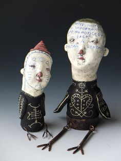 """left: """"Bird Boy"""". right: """"Most Things of Importance"""". All ceramic with copper bird legs."""