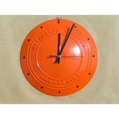 "The Coalbrookdale, Tangerine Dream  Cast iron face. Finished in glossy tangerine and black Accurate quartz mechanism. Brass fittings. 11 ½"" (29cm) diameter."