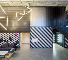 London firm Jump Studios has renovated a battery factory in Madrid… Office Interior Design, Office Interiors, Ceiling Design, Wall Design, Roof Top Cafe, Open Concept Office, Office Canteen, Student House, Co Working