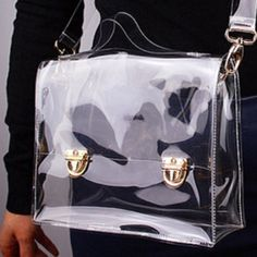 Transparent / Clear Handbag / Cross Body Bag Perfect for Sports Event, Concert, Amusement Park, or Work - ease through security screen. Can use it as a tote or handbag (handle) or shoulder or cross body bag (strap). See photo for dimensions. The detachable shoulder strap is 37 inches long. It has a spacious compartment for all your goodies, see photo w/ my stuff for baseball game; this one is mine  Selling you a brand new one. Flap with decorative clasps/locks. Made of alloy, like plastic…