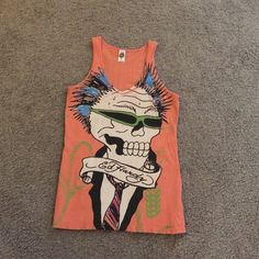 Auth Ed Hardy tank Women's size large orange Ed Hardy tank top. Perfect for summer!!! Front has a skeleton head with green glasses and blue hair. Background on front is lime green rope also all over the backside. Says Ed Hardy in yellow across the top of the back. Excellent condition!!! Ed Hardy Tops Tank Tops