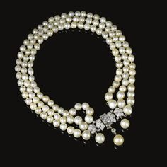 FORMERLY IN THE COLLECTION OF BARONESS DE RENZIS SONNINO: Natural pearl and diamond necklace, Bulgari. The choker composed of three rows of graduated natural pearls, embellished at the front with a scroll and geometric clasp set with brilliant-cut, cushion-shaped and baguette diamonds, suspending three natural pearl drops.