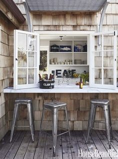 What if we did this to our big kitchen window?? Love the bar seating outside.