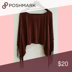 Maroon Gypsy Cape Beautiful maroon gypsy cape. Wide arm holes and open back. Size XS, but roomy (I'm a size medium and it fit me perfectly). Good condition, no rips tears or stains. Brand is Haute Hippie. Haute Hippie Tops Blouses