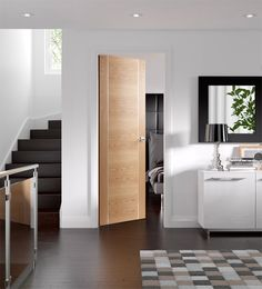 Forli Internal Oak Door with silver aluminium strips and clear finish