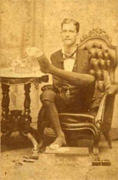 Born in 1855 in Woodstock, Ontario, Charles B. Tripp was entirely without arms. He learned to dress himself, shave, and write using his feet and became a very skilled cabinet maker, incorporating intricate wood inlay designs into his cabinets. In fact, Charles made his primary living as a carpenter.