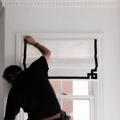 This is outside mount on the window frame Roman shade Greek key black and white contemporary white and black minimalist classic traditional transitional eclectic