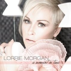 "The Cover Of Lorrie's ""A Moment In Time"" album. It's awesome!"