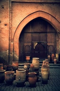 Antique Moroccan Garden Pots in front of an arched doorway. Marrakesh.
