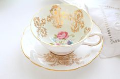 This set's pattern is a celebration of formal elegance with a touch of English cottage charm. Our cup and saucer have been happily married. The cup reads Royal Grafton and the saucer reads Paragon. Photographs are also part of the description. All photos are taken in natural light