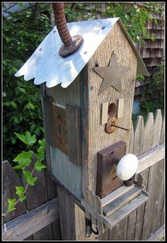 Bird house made out of bits and pieces.