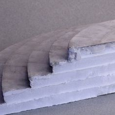 Glued tiers of foamboard used to make a set of semicircular stone steps in dollhouse scale. - Photo © 2011 Lesley Shepherd
