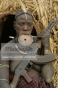 Mursi Tribeswoman With Gun, Omo Valley, Ethiopia - Stock Photos : Masterfile Namaste, Mursi Tribe, Warrior Queen, Ethiopia, Guns, Stock Photos, World, People, Image