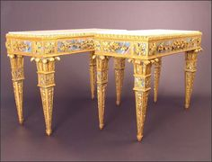 PAIR OF SICILIAN NEOCLASSIC GILTWOOD AND VERRE EGLOMISE CONSOLES  with rectangular inset white marble top within carved and pierced egg and dart molded frame with applied carved and molded meandering foliate reserves. Circa 1770 – 1785.