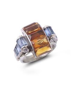 RENE BOIVIN. A citrine, sapphire and diamond ring. Designed as a central domed…