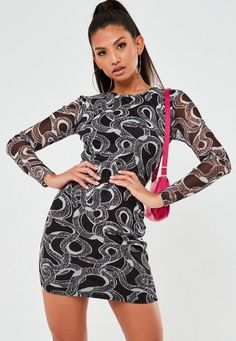 """black snake print mesh mini dress featuring a crew neckline and body underlining.    regular fit     Mini - Sits mid thigh    96% Polyester 4% Elastane    Pilar wears a UK size 8 / EU size 36 / US size 4 and her height is 5'9"""""""