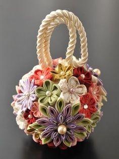 Idea: Make flower ball by gluing handmade kanzashi blooms onto foam ball. Cloth Flowers, Felt Flowers, Diy Flowers, Fabric Flowers, Paper Flowers, Flower Bouquets, Ribbon Art, Ribbon Crafts, Flower Crafts