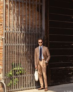 A last, final image of Andreas Weinås in the italian suit along with the Retro Specs sunglasses.