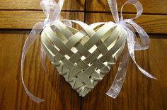 White, reed heart basket with lavender bows. Perfect for a flowergirl!