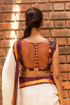 We are so tripping on details this season! Check out another cool number in a maroon kalamkari fabric having a sheer net back with shimmer button detailing. This would be a lovely and versatile kalamkari addition to any wardrobe.Endless pairing options abound…pair with any saree or skirt having maroon in it. Or just pair with a plain saree in any of the blouse colors and be easy breezy. #kalamkari #saree #india #blouse #houseofblouse