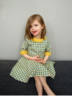 circle skirt and asymmetrical collar