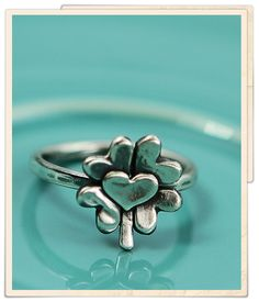 lucky in love ring.  I'd love this. To represent my kids and grandma. (Her birthday was St.Patricks Day)