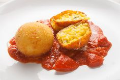"""Recipe for rice balls or arancini (Italian for """"little oranges""""). Also known as deep-fried risotto balls"""