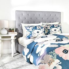 Bring some soft, feminine style to your sleeping space with the lovely DENY Designs Khristian A Howell Une Femme Duvet Cover. Soothing pink, lavender, and cream blooms adorn a muted blue ground on this lightweight, ultra soft fabric.