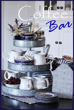 THE PORTABLE COFFEE, TEA, AND/OR HOT CHOCOLATE BAR * A TIN TIERED SERVER WITH MUGS, TEA BAGS, SUGAR, CREAM, COCOA PACKETS,  SILVERWARE, AND CLOTH NAPKINS.  PROVIDE FRUITS, PETITE SANDWICHES & APPETIZERS OR SNACKS WITH A STACK OF COORDINATING PLATES TO THE SIDE.