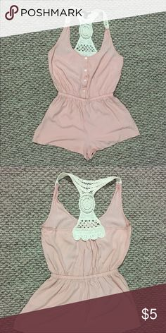 Blush Forever 21 Romper w/ Crochet Detail Blush F21 romper with racerback crochet back, button-down front and cinched waist, fun and flirty for summer events.   Size Medium, fits size 6-8  Lightweight material 100% rayon  Pairs well with tennis shoes or flats and a cardigan, or even paired with a high-waisted skirt to shift the focus to the crochet back.   Feel free to comment below with any questions. Forever 21 Shorts