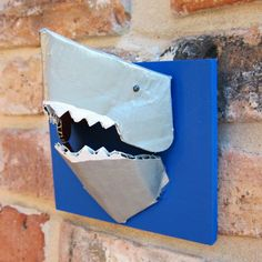 Shark!!  Could be lego / misc toy holder ... or decor ... or whatever, it looks easy to make and might be fun for shark-boy's big-boy room (AKA; pretty much just pinning cuz it's cool-lookin, might be inspiration for something later ... might not ... we'll see)