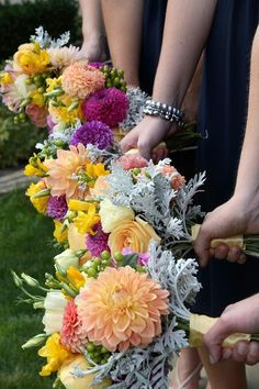 Bridesmaid bouquets with dahlias, roses, freesia, lisianthus, hypericum and dusty miller; Blumengarten Florist; www.blumen.com; Photo by www.moodsimage.com