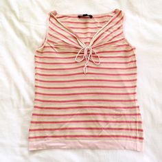 BANANS REPUBLIC striped tank with tie front XS Super cute BANANA REPUBLIC striped tank with alternating pink, light pink stripes. Faux front tie. Excellent condition with no signs of wear! I also have this in a light purple color! Banana Republic Tops Tank Tops