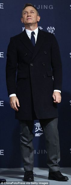 Suits you: Daniel favoured his signature style, picking out a classic black two-piece suit...