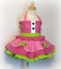 Great for pageant wear, parties, etc. Sweet 2pc dress that includes bustier halter top and triple layer skirt.Top has a smocked/shirred back to ensure a nice fit and tie halter straps.  Twirl circle skirt has three layers and middle layer has fishline hem, underskirt is white cotton with lime ruffles.  Add your pettiskirt (not included), for lots of fullness and tons of twirling fun!