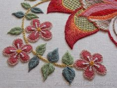 Simple crewel embroidery spray of flowers.