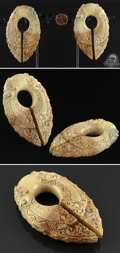Fossilized mammoth ivory carved keyhole ear weights.
