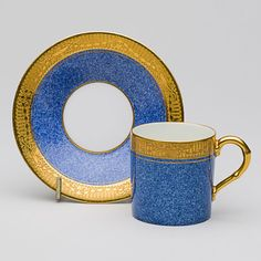 Attractive bone china coffee can and saucer, acid etched gold design around the top of the cup and the rim of the saucer.