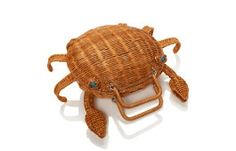 for our splash out collection, our designers created a bevy of witty, eccentric designs that celebrate the season. case in point: this wicker crab, sure to add a considerable dose of charm to anything you wear this summer.