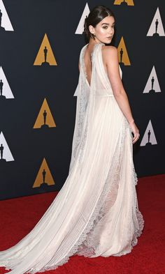 Hailee Seinfeld in a cream Elie Saab couture dress - click ahead to see more dresses from the back